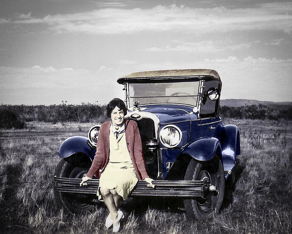 Restored and colored 1930s photo of a car and woman